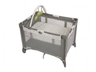 a photo of a graco bassinet playard with automatic folding feet