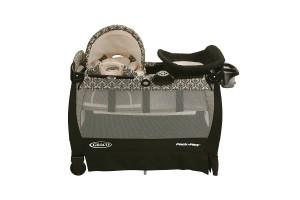a famous graco playard with cuddle cove rocking seat