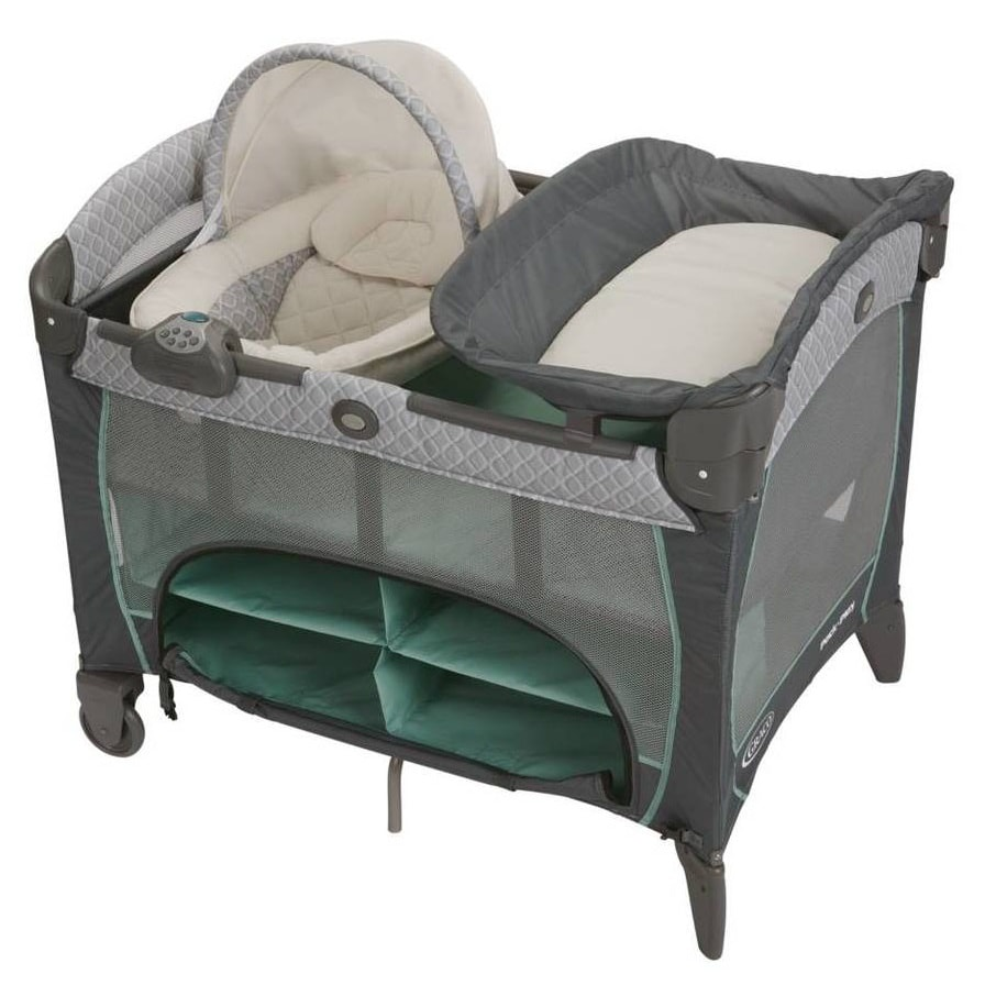 a nice playard with a newborn napperstation