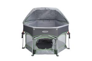 a graco playard with an open canopy