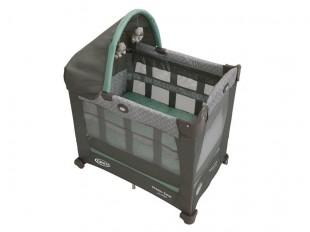 a graco travel lite crib with a bassinet