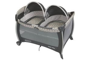 a photo of a popular graco playard for twins with bassinet