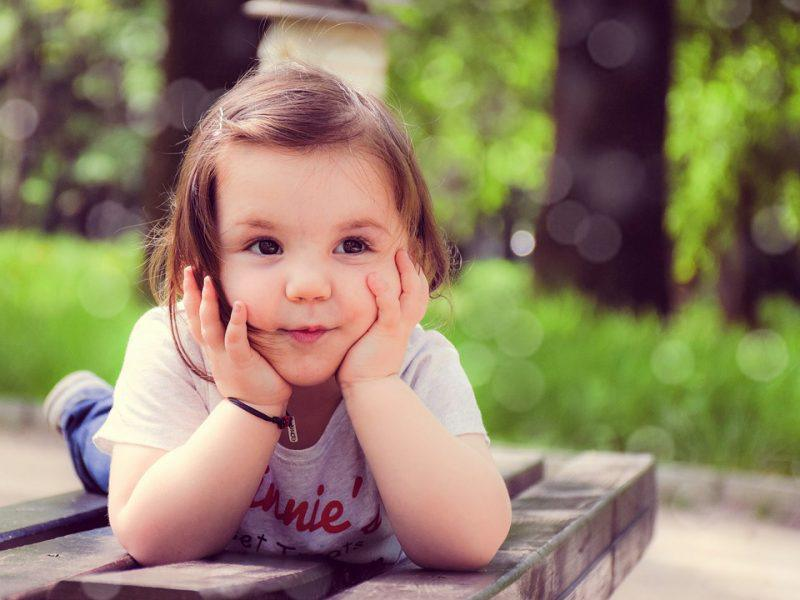Little girl posing for a camera