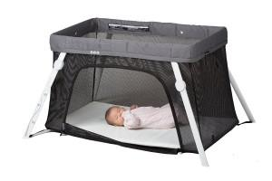 a baby sleeping in a pack-n-play