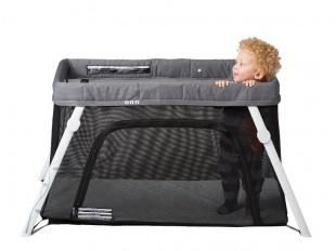 a kid playing in a comfortable playard