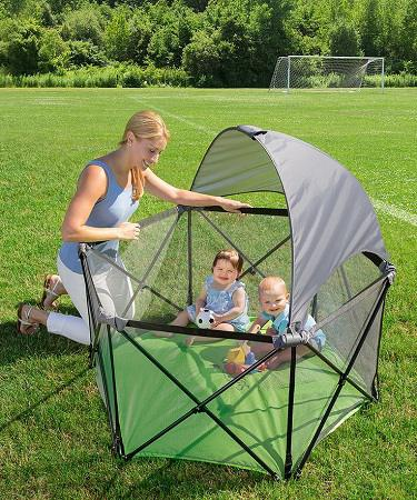 kids protected from the sun by a canopy